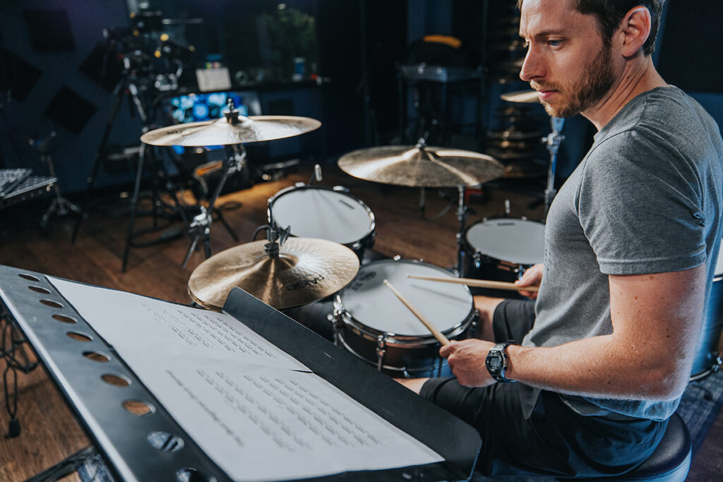 drummer reading sheet music